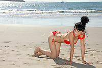 Bai Ling<br /> beats the summer heat in a hot red bikini on the beach during the hottest Southern California summer weekend so far, Marina Del Rey, CA 09-14-14<br /> David Edwards/DailyCeleb.com 818-249-4998