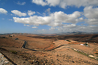 Landscape of Fuerteventura countryside,showing small farms and an empty road. Fuerteventura, Canary Islands, Spain.