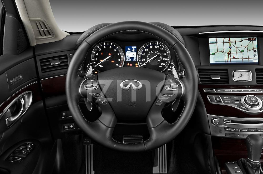 Steering wheel view of a 2011 Infiniti M37S Sedan
