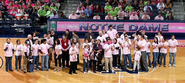 Feb. 12, 2011; University of Notre Dame cancer researchers are honored during a timeout of the 2011 Pink Zone game.
