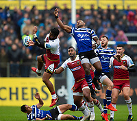 Ahsee Tuala of Northampton Saints and Semesa Rokoduguni of Bath Rugby compete for the ball in the air. Gallagher Premiership match, between Bath Rugby and Northampton Saints on September 22, 2018 at the Recreation Ground in Bath, England. Photo by: Patrick Khachfe / Onside Images