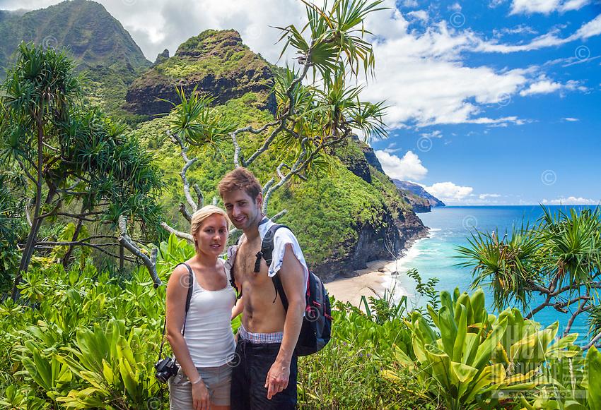 Hikers on the Kalalau Trail with Hanakapi'ai Beach in the distance, North Kaua'i.