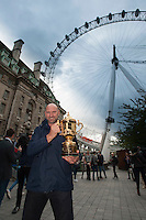 Former World Cup winner Laurence Dallaglio stands with the Webb Ellis Cup in front of the London Eye to launch Rugby World Cup England 2015- 15/09/2015 - London Eye - London <br /> Mandatory Credit: Rob Munro/Stewart Communications
