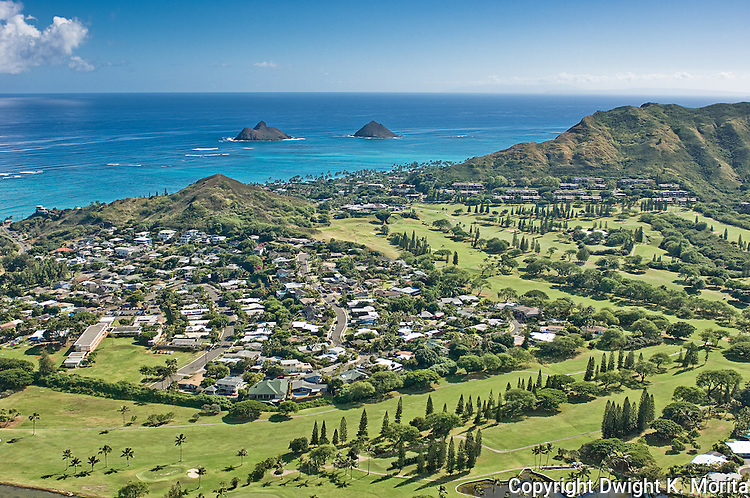Aerial view of the Mid-Pacific Country Club golf course. The third, sixth, and seventh fairways are in the foreground. The Mokulua Islands and the Bluestone condominiums are in the distance.
