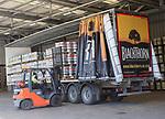 Forklift loading barrels onto trailer, Showerings cider mill, Shepton Mallet, Somerset, England, UK