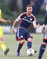 New England Revolution defender Chris Tierney (8) passes the ball. In a Major League Soccer (MLS) match, the New England Revolution tied the Columbus Crew, 0-0, at Gillette Stadium on June 16, 2012.