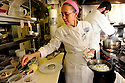 Bayona owner and chef Susan Spicer cooks with LSU's Jazzmen rice, New Orleans, Thurs., Dec. 10, 2009..(AP Photo/Cheryl Gerber)
