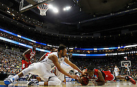 PITTSBURGH, PA - MARCH 21:  Darrun Hilliard II #4 of the Villanova Wildcats and Desmond Lee #5 of the North Carolina State Wolfpack go after the ball in the first half during the third round of the 2015 NCAA Men's Basketball Tournament at Consol Energy Center on March 21, 2015 in Pittsburgh, Pennsylvania.  (Photo by Jared Wickerham/Getty Images)