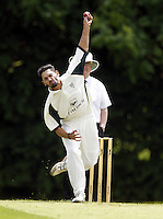 Anees Davids bowls for North London during the Middlesex County Cricket League Division Three game between Wembley and North London at Vale Farm, Wembley on Sat May 31, 2014