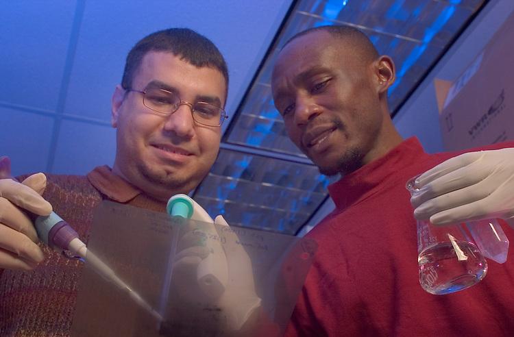 Susan Evans EBI labs:..Students, Ahmed Malki(glasses) & Bernard Ayanga(left)