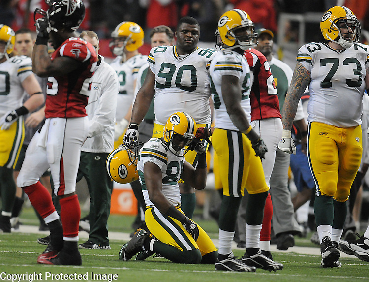 Green Bay Packers receiver Greg Jennings kneels after failing to score on a last second effort against the Atlanta Falcons during the fourth quarter of the game at the Georgia Dome in Atlanta, Ga., on Nov. 28, 2010.  From left are Atlanta Falcons' William Moore and Packers B.J. Raji (90) James Jones and Daryn Colledge.