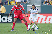 Landon Donovan of the LA Galaxy battles Collins John of Chicago Fire. The Chicago Fire beat the LA Galaxy 3-2 at Home Depot Center stadium in Carson, California on Sunday August 1, 2010.