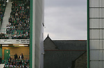 Hibernian 4, Peterhead 0, 22/08/2006. Easter Road Stadium, Scottish League Cup. Premier League side Hibernian (green) take on Division Two newcomers Peterhead  in the CIS Insurance (League) Cup second round tie at Easter Road. The home team won the tie 4-0. The stadium has been completely redeveloped in the last 10 years and average attendances have climbed in that period. Hibs were formed in 1875 and traditionally drew their support from Catholics and people in the port of Leith, although the ground is in Edinburgh. Picture shows a seagull getting a bird's eye view of the action. Photo by Colin McPherson.