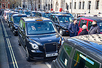 Licensed taxi Drivers block Parliamment Square, Whitehall and surrounding streets.They are protesting against the Mayor of London and TFL who have denied them access to Bank, Tottenham Court Road, Tooley Street, Greenwich, Lewisham, Islington and Hackney. They claim that the Mayor of London and TFL are engineering the destruction of the licensed Taxi trade through closing streets to them.