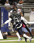 San Diego State's Colin Lockett gets called for pass interference against Nevada's Charles Garrett during the second half of an NCAA college football game in Reno, Nev., on Saturday, Oct. 20, 2012. San Diego State won 39-38 in overtime. (AP Photo/Cathleen Allison)