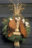 wreath, Colonial Williamsburg, Virginia, VA, Williamsburg, A spray made of greens, cotton, dried tobacco leaves, and wheat decorates the iron railing of the village store for Christmas in Colonial Williamsburg.