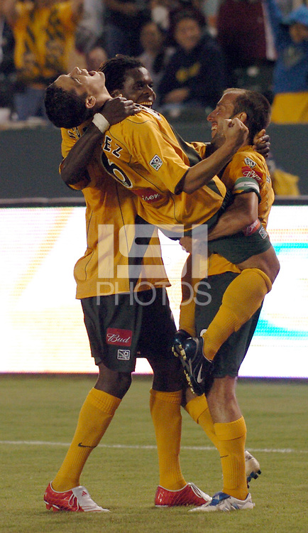 Los Angeles Galaxy's Herculez Gomez gets a hug from teammate (8,right) Guillermo Gonzalez and Joseph Ngwenya after scoring a goal against FC Dallas in the first half at the Home Depot Center in Carson, CA on Saturday night, October 1, 2005..(Matt A. Brown/ISI)