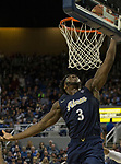 Akron forward Daniel Utomi (3) dunks the ball against Nevada in the second half of an NCAA college basketball game in Reno, Nev., Saturday, Dec. 22, 2018. (AP Photo/Tom R. Smedes)