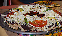 Tlayuda Especial with cecina (roasted pork) at Casa Oaxaca in Santa Ana.  The tlayuda was similar to a pizza, with a large crispy tortilla making the crust, and a bean mole (flavored with avocado leaves to give it a hint of anise flavor) as the sauce.  Hard to cut, but very tasty!