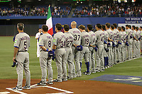 March 7, 2009:  Marco Mazzieri, Nick Punto, Davide Dallospedale, Frank Catalanotto, Valentino Pascucci, Chris Denorfia, Mike Costanzo, Giuseppe Mazzanti, and the rest of Italy during the first round of the World Baseball Classic at the Rogers Centre in Toronto, Ontario, Canada.  Venezuela defeated Italy 7-0 in both teams opening game of the tournament.  Photo by:  Mike Janes/Four Seam Images