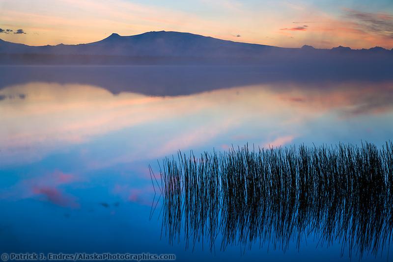 Mount wrangell reflected in willow lake at sunrise with morning fog. Wrangell Mountains, Wrangell St. Elias National Park, Alaska.