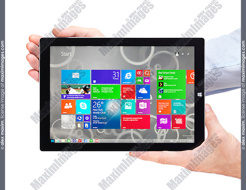 Person hands holding Microsoft Surface Pro 3 tablet computer isolated on white background