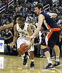Nevada's Deonte Burton drives through Bucknell defenders Bryson Johnson, rear, and Mike Muscala during a second round NIT college basketball game in Reno, Nev. , on Sunday, March 18, 2012. Nevada won 75-67..Photo by Cathleen Allison