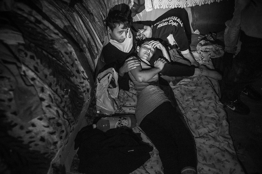 Mona, 19, is pregnant with her second child. She lives underground with her cousins and boyfriend and daughter along with other youth in Bucharest's vast system of underground canals used for heating, water and sewage pipes.