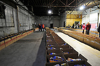 NWA Media/ J.T. Wampler - Volunteers prepare to distribute food boxes Wednesday Dec. 24, 2014 in Bentonville. The Bentonville Kiwanis  Club distributed 540 boxes of food to area families Wednesday.