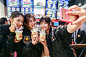 Members of staff take a selfie during the pre-opening event for the Japan's first Carl's Jr. burger restaurant located in Tokyo's Akihabara district, on March 2, 2016, Japan. The Californian fast food restaurant follows on the heels of Shake Shack in entering the Japanese market. Mitsuuroko Group Holdings Co., Ltd. has signed a franchise agreement to operate Carl's Jr. branches in Japan with the first to open to the public on March 4th. (Photo by Rodrigo Reyes Marin/AFLO)