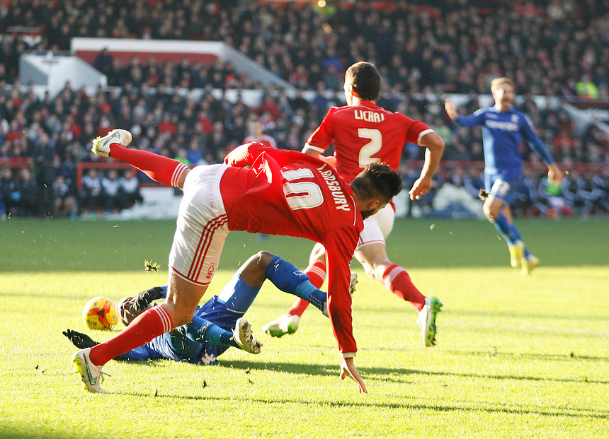 Nottingham Forest's Henri Lansbury fouls Birmingham City's Demarai Gray (L)<br /> <br /> Photographer Jack Phillips/CameraSport<br /> <br /> Football - The Football League Sky Bet Championship - Nottingham Forest v Birmingham City - Saturday 28th December - The City Ground - Nottingham<br /> <br /> &copy; CameraSport - 43 Linden Ave. Countesthorpe. Leicester. England. LE8 5PG - Tel: +44 (0) 116 277 4147 - admin@camerasport.com - www.camerasport.com