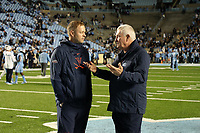 CHAPEL HILL, NC - NOVEMBER 02: Head coach Bronco Mendenhall of the University of Virginia listens to head coach Mack Brown of the University of North Carolina during a game between University of Virginia and University of North Carolina at Kenan Memorial Stadium on November 02, 2019 in Chapel Hill, North Carolina.