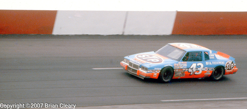 Richard Petty's #43 Pontiac Grand Prix races through the banking during  the Southern 500 at Darlington Raceway in Darlington SC on September 1, 1985. (Photo by Brian Cleary/www.bcpix.com)