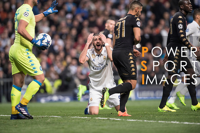 Karim Benzema of Real Madrid kneels on the picth during the match Real Madrid vs Napoli, part of the 2016-17 UEFA Champions League Round of 16 at the Santiago Bernabeu Stadium on 15 February 2017 in Madrid, Spain. Photo by Diego Gonzalez Souto / Power Sport Images