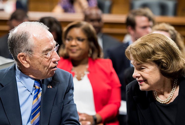 UNITED STATES - JUNE 28: Chairman Sen. Chuck Grassley, R-Iowa, speaks with ranking member Sen. Dianne Feinstein, D-Calif., before the start of the Senate Judiciary Committee markup hearing on Thursday, June 28, 2018. (Photo By Bill Clark/CQ Roll Call)