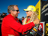Feb 12, 2017; Pomona, CA, USA; NHRA top fuel driver Leah Pritchett (right) celebrates with team owner Don Schumacher after winning the Winternationals at Auto Club Raceway at Pomona. Mandatory Credit: Mark J. Rebilas-USA TODAY Sports