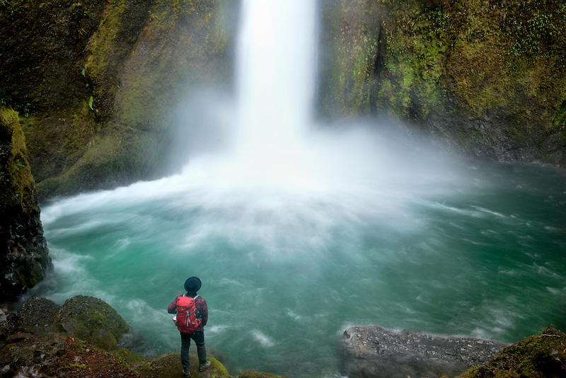 Hiker at Wahclella Falls, also called Tanner Creek Falls. Columbia River Gorge National Scenic Area, Oregon