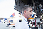 Delta First Officer Michael Maier does an external inspection of a Delta 777 plane before a flight at the Maynard H. Jackson Jr. International Terminal at Hartsfield–Jackson Atlanta International Airport, in Atlanta, Georgia on August 28, 2013.