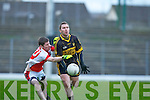 John Moynihan Rathmore tackles Currow John Buckley during their O'Donoghue cup semi final in Fitzgerald Stadium on Sunday
