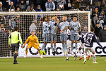 Miguel Layun of C.F Monterrey (21, right) scores over a wall of Sporting KC defenders during their CONCACAF Champions League semifinal soccer game on April 11, 2019 at Children's Mercy Park in Kansas City, Kansas.  Photo by TIM VIZER/AFP