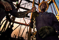 Oil Workers.This is a war where there are no white hats, and Sudanese work on both sides of the border.  Dinka oilfield workers sneak through enemy lines back to their villages after their tour on the oil platform is over...Story Summary:.Sudan, the largest country in Africa, hosts a civil war between the Islamic North and the African South that has the highest casualty rate of any war since World War II...Two and a half million people have been killed in this insidious conflict.  It drags on because Southerners have no voice, and the Northerners have engineered ÒThe Perfect WarÓ where none of their people are killed...The North forces people out of the South by bombing them, burning their crops, and harassing them with gunships. They abduct their children and draft them to fight with the Northern armyÑforcing southerners to fight their own brothers...This story is particularly interesting now because there is a small window for peace in a civil war that has been dragging on since the end of colonial rule.  The war has always been about tribal issues and ideologyÉ but more than that, it is about resources.  This clash over resources may bring peace.  The North controls the pipeline and the only port, and the South controls the land...The story of Sudan has always been the continual transference of wealth from the resources of the south to the elite few who live in the deserts of the north.  And the sucking sound in the middle of the country is from the corrupt government in northern Khartoum..