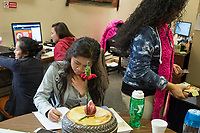 Socheata Mam, 19, (seated left) studies before a Lunar New Year celebration at Middlesex Community College's Asian American Connections Center on Thus., Feb. 15, 2018. Mam is a Cambodian-American first year student studying Criminal Justice. The Asian American Connections Center was established at the school using a federal grant in 2016 and serves as a focal point for the Asian community at the school, predominantly Cambodian, to gather, socialize, study, and otherwise take part in student life.