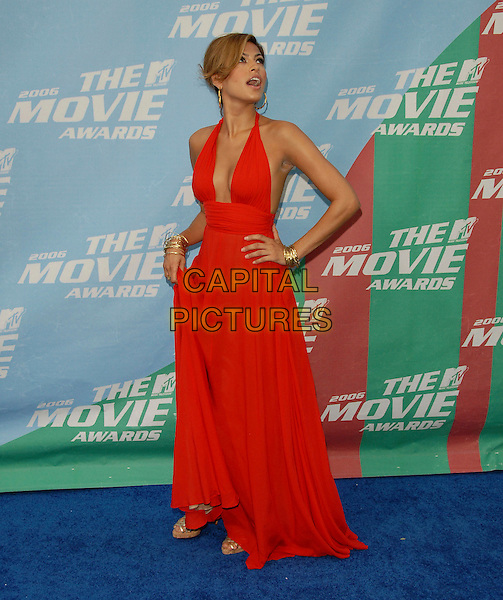 EVA MENDES.The 2006 MTV Movie Awards - Arrivals, held at The Sony Picture Studios in Culver City, Los Angeles, California, USA, June 3rd 2006..full length long halterneck red dress hand on hip low cut funny.Ref: DVS.www.capitalpictures.com.sales@capitalpictures.com.©Debbie VanStory/Capital Pictures