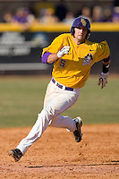 Cameron Freeman #5 of the East Carolina Pirates rounds second base at Clark-LeClair Stadium on February 20, 2010 in Greenville, North Carolina.   Photo by Brian Westerholt / Four Seam Images