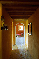 A shaft of sunlight illuminates this tiled corridor