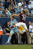 Rapids midfielder Wells Thompson (15) wins the aerial battle with Sporting defender Seth Sinovic..Sporting Kansas City defeated Colorado Rapids 2-0 in Open Cup play at LIVESTRONG Sporting Park, Kansas City, Kansas.