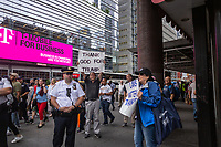 NEW YORK, USA - August 23 : Pro Trump demonstrators are seen holding signs in a protest to demand Greyhound collaboration with ICE on August 23, 2019 in New York, USA.<br /> Everyday across the U.S., ICE, DHS and Border Patrol agents board buses with Greyhound's permission and attempt to detain migrants. Demonstrators at the Port Authority bus terminal demand Greyhound to end all collaboration with ICE and Border Patrol. <br /> (Photo by Luis Boza/VIEWpress)
