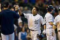Anthony Rendon #23 of the Rice Owls is congratulated by teammates after hitting a 3-run home run in the 5th inning versus the Baylor Bears in the 2009 Houston College Classic at Minute Maid Park March 1, 2009 in Houston, TX.  The Owls defeated the Bears 8-3. (Photo by Brian Westerholt / Four Seam Images)