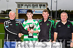 John O'Regan presents the cup to Killarney celtics captain Fergal O'Donoghue after winning  the Denny Youths Final Killarney Celtic v Park FC at Mounthawk Park on Sunday. Pictured also Sean O'Keefe and Denis Guerin