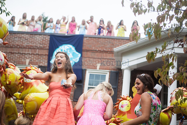 A sister of Alpha Delta Pi squeals with excitement during UK's sorority bid day in Lexington, Ky., on Friday, August 22, 2014. Photo by Adam Pennavaria | Staff